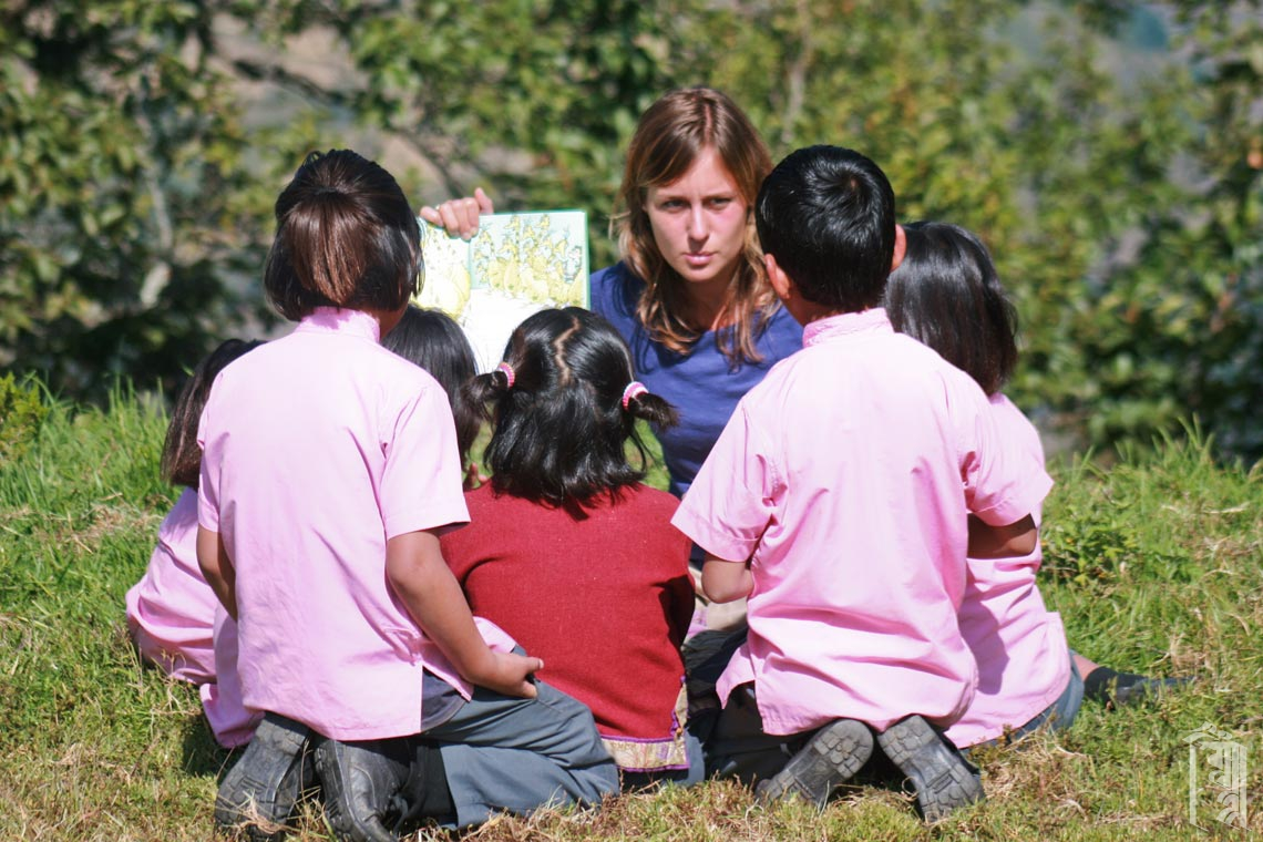 A young volunteer teacher at Jhamtse Gatsal teaches her class outside on a beautiful day.
